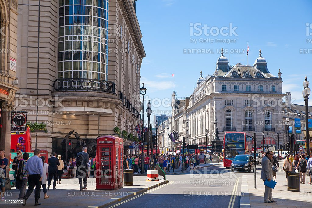 People and traffic in Piccadilly Circus, London stock photo