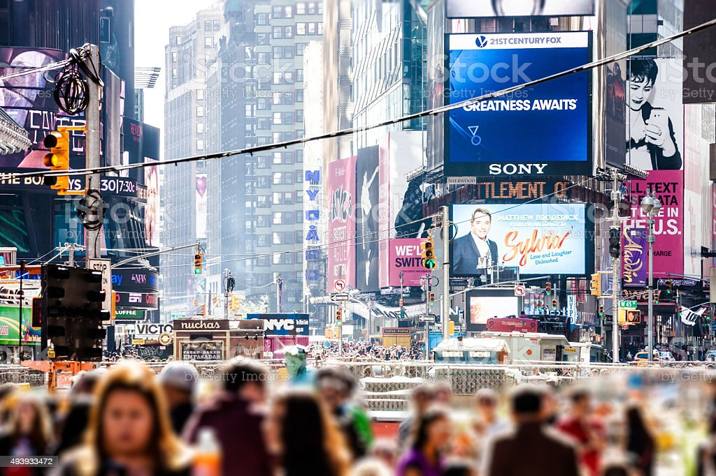 People and traffic in Times Square stock photo