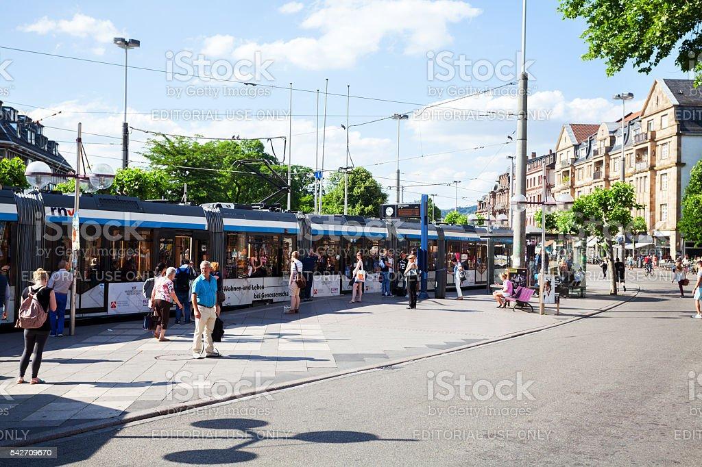 People and tram at Bismarckplatz in Heidelberg stock photo