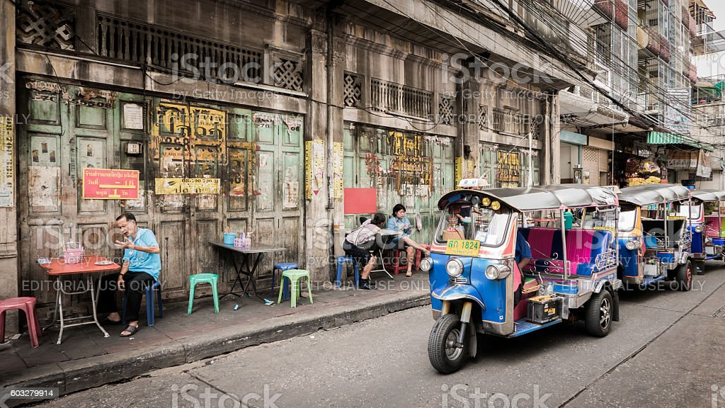 People and tuktuk taxi with background classic door. stock photo
