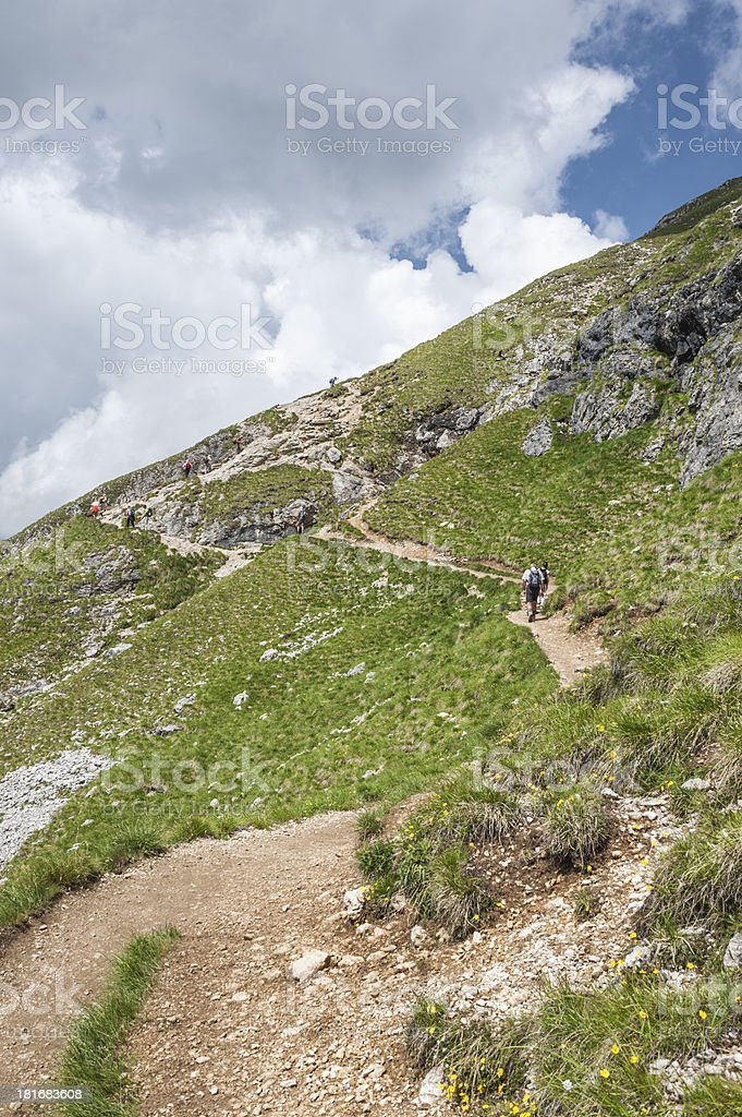People are climbing along a hiking trail in the Dolomites stock photo