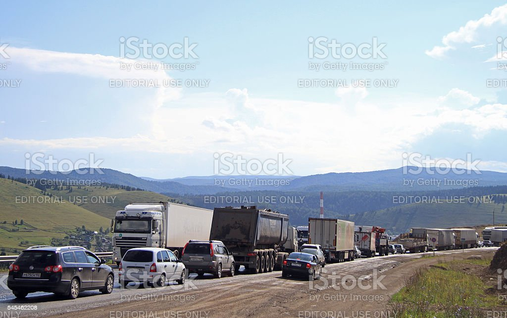people are driving cars in traffic congestion nearly village Sim stock photo