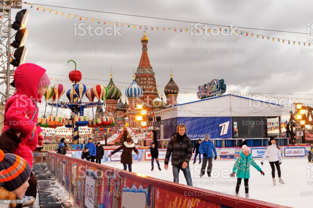 People are enjoying ice skating in Kremlin Red Square stock photo