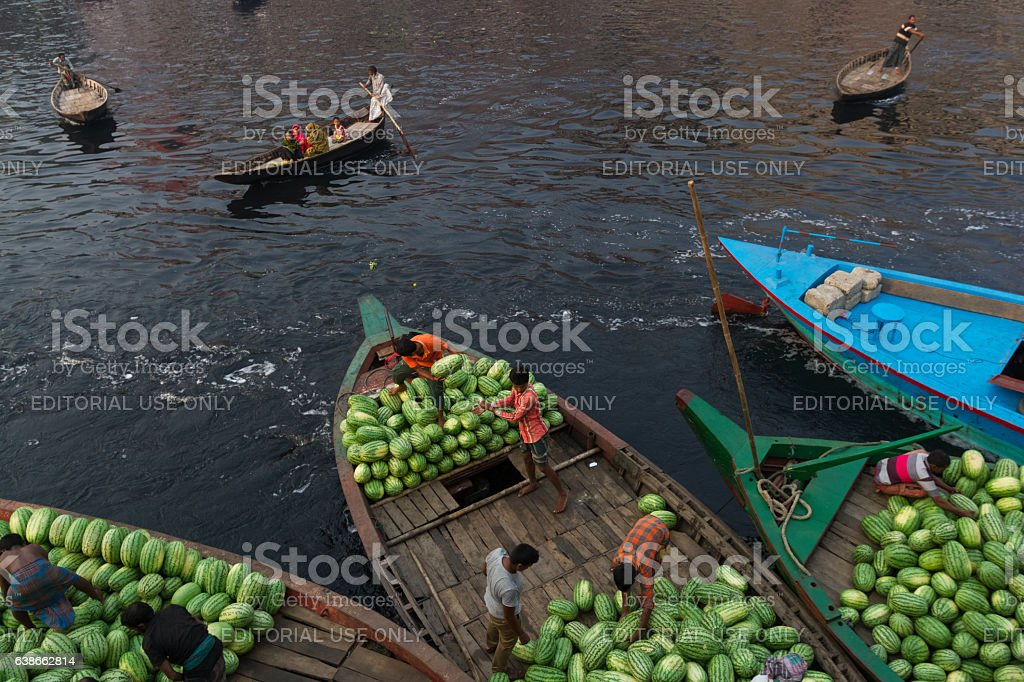 People are loading watermelons to boat from ferry in Bangladesh stock photo