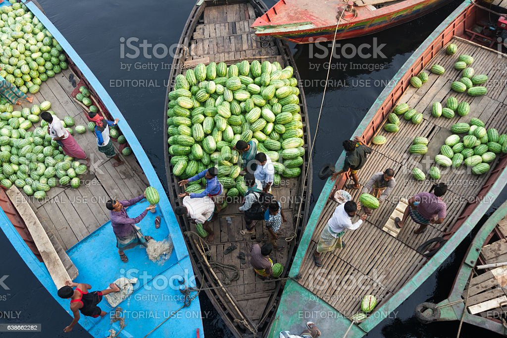 People are loading watermelons to boat from ferry loaded stock photo