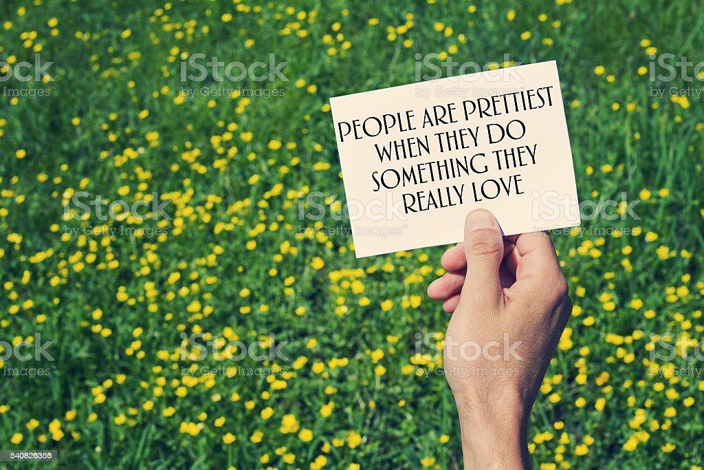 People are  prettiest when then do something they  love. stock photo