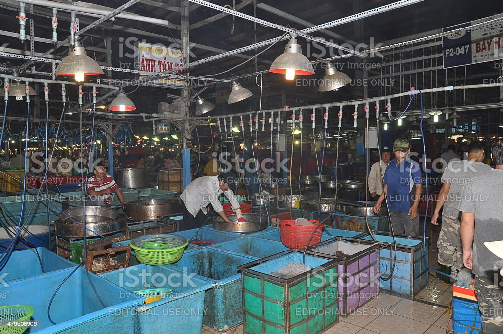 People are purchasing seafood at a local market stock photo