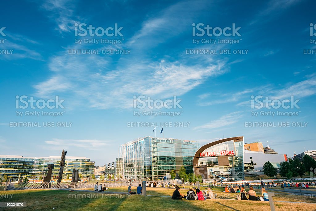 People are relaxing in front of Kiasma museum and Sanoma stock photo