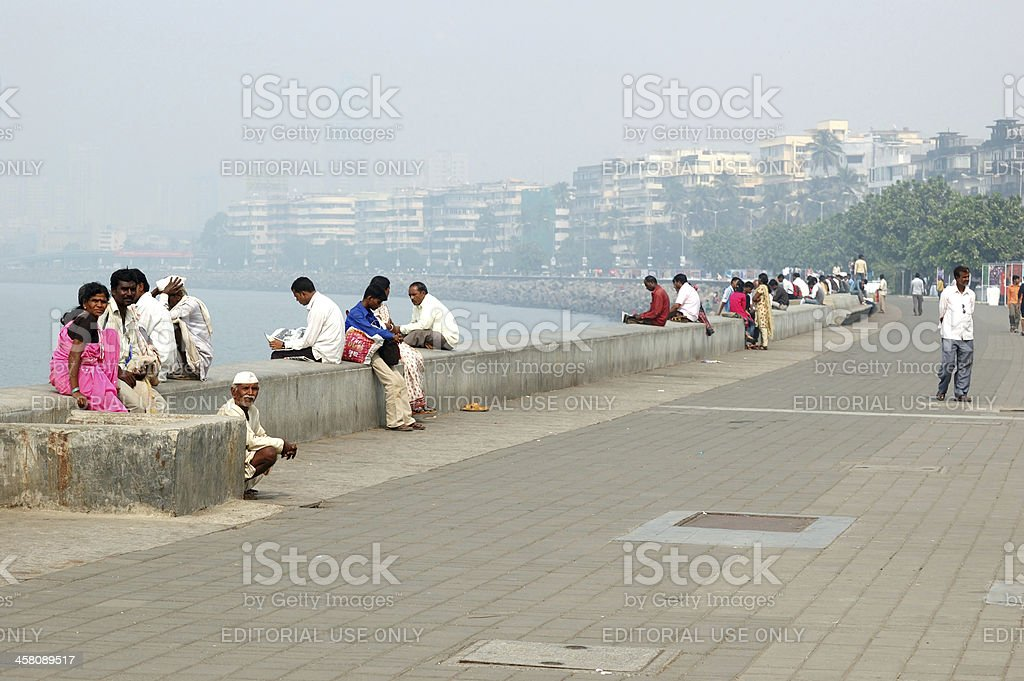 People are resting at Marine Drive boulevard in Mumbai,India royalty-free stock photo
