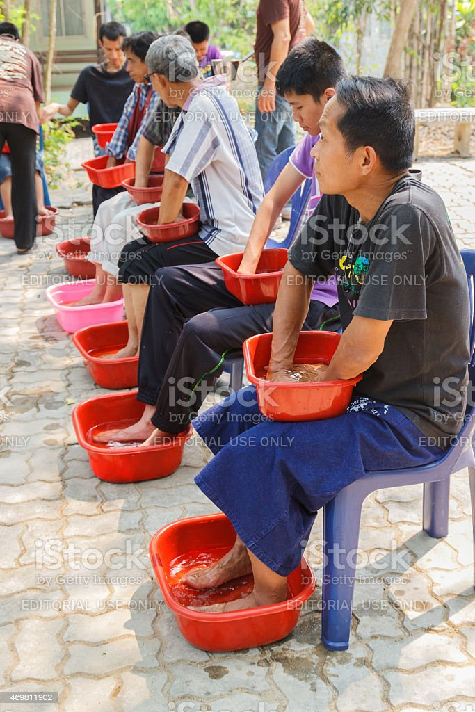 People are soaking their hands and feet with herbal water stock photo