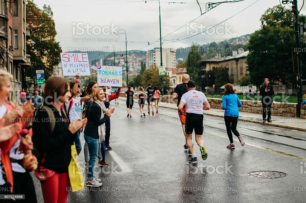 People are supporting their runners stock photo