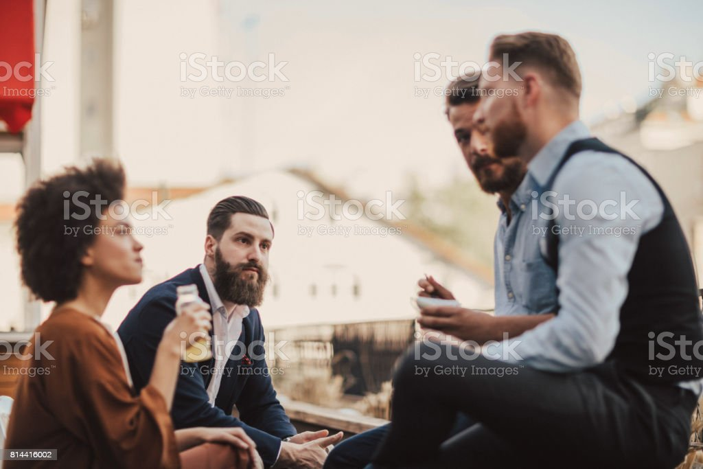 People are talking about business during lunch break stock photo