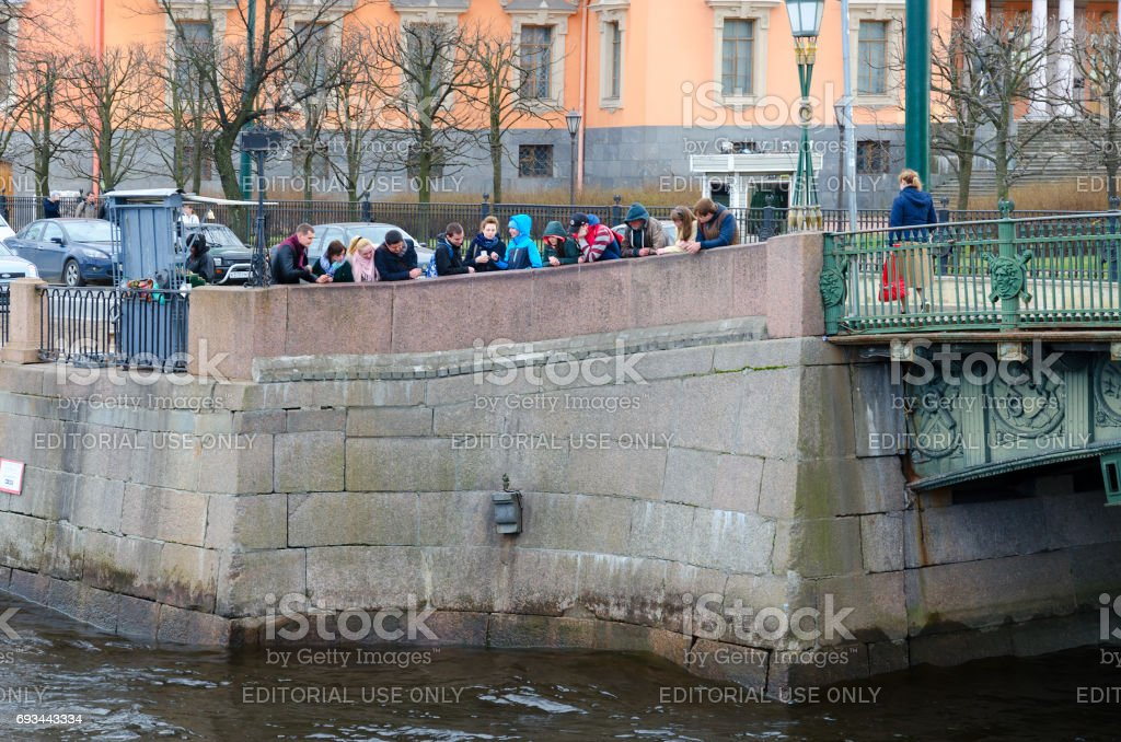 People are viewing Chizhik-Pyzhik monument on Fontanka River embankment, St. Petersburg, Russia stock photo