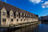 People are visiting downtown by leie river at ghent belgium