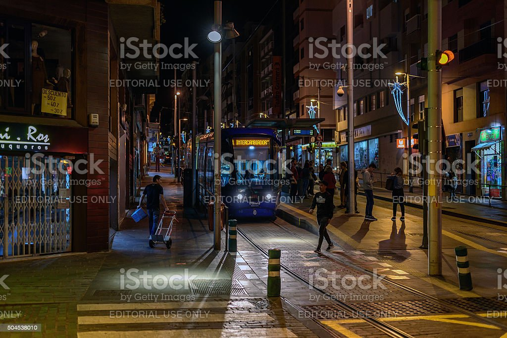 People are waiting for tram at night street stock photo