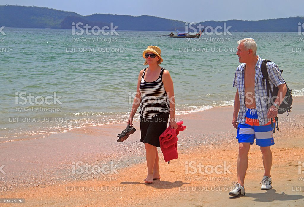 people are walking by Ao Nang beach stock photo