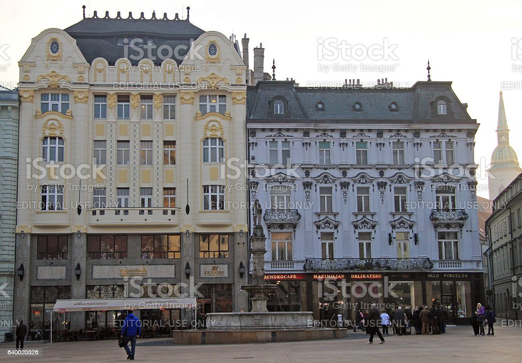 people are walking by the main square in Bratislava, Slovakia stock photo