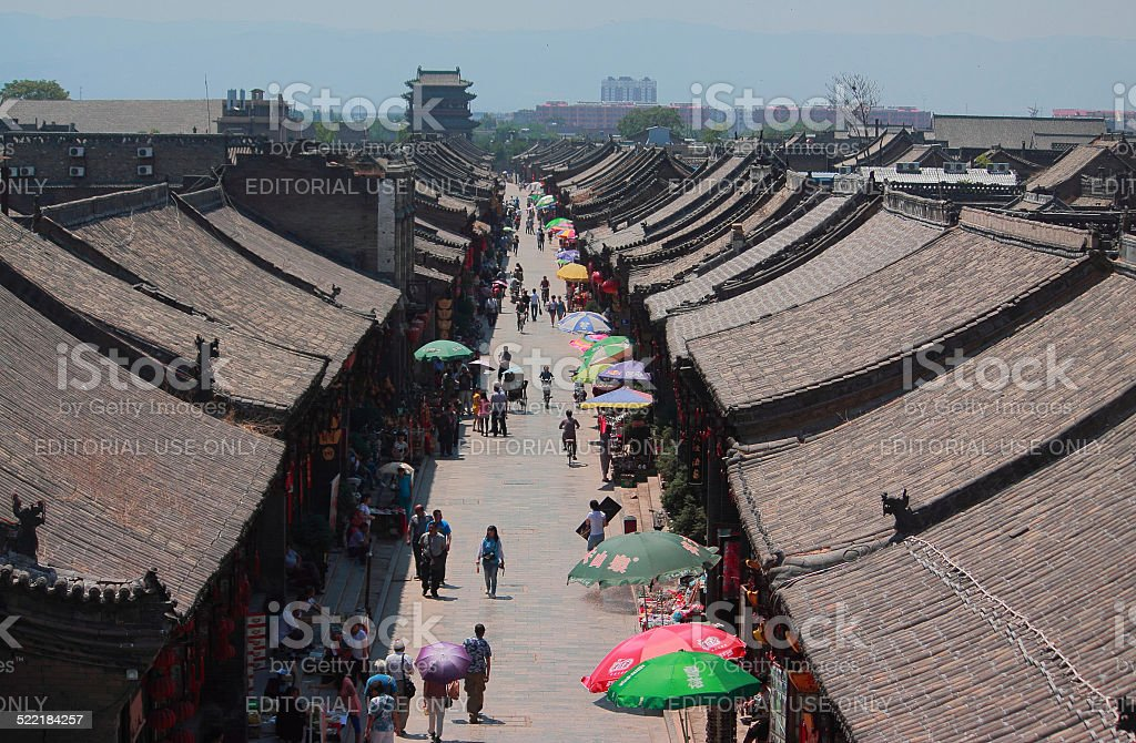people are walking on the pedestrian street in Pingyao stock photo
