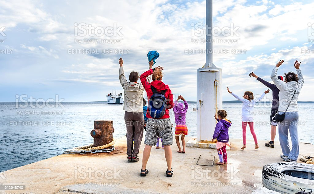 People are waving and saying goodbyes stock photo