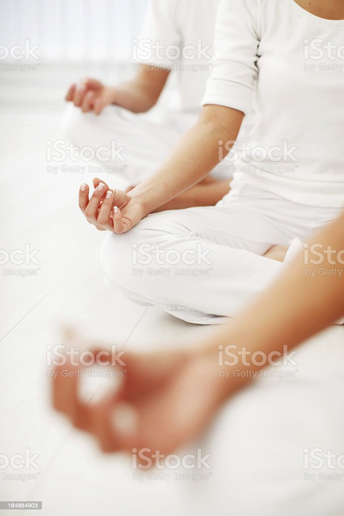 People are working yoga, sitting in lotus pose. royalty-free stock photo