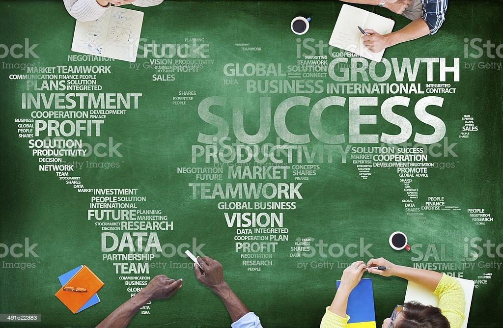 People Around Blackboard With Global Success stock photo
