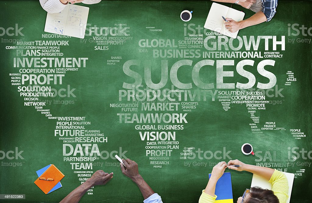 People Around Blackboard With Global Success stock photo