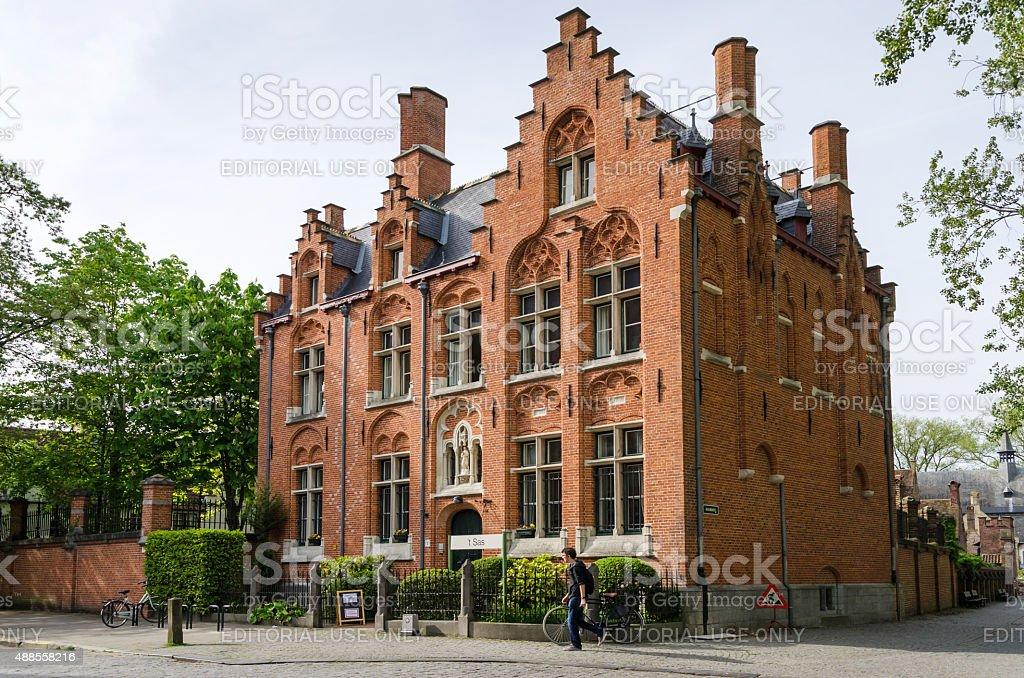 People around the Beguinage (Begijnhof) in Bruges, Belgium. stock photo
