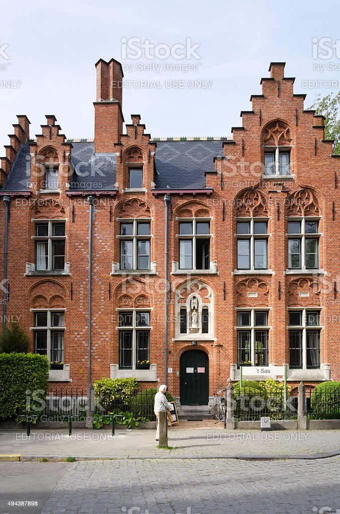 People around the Beguinage (Begijnhof) in Bruges stock photo