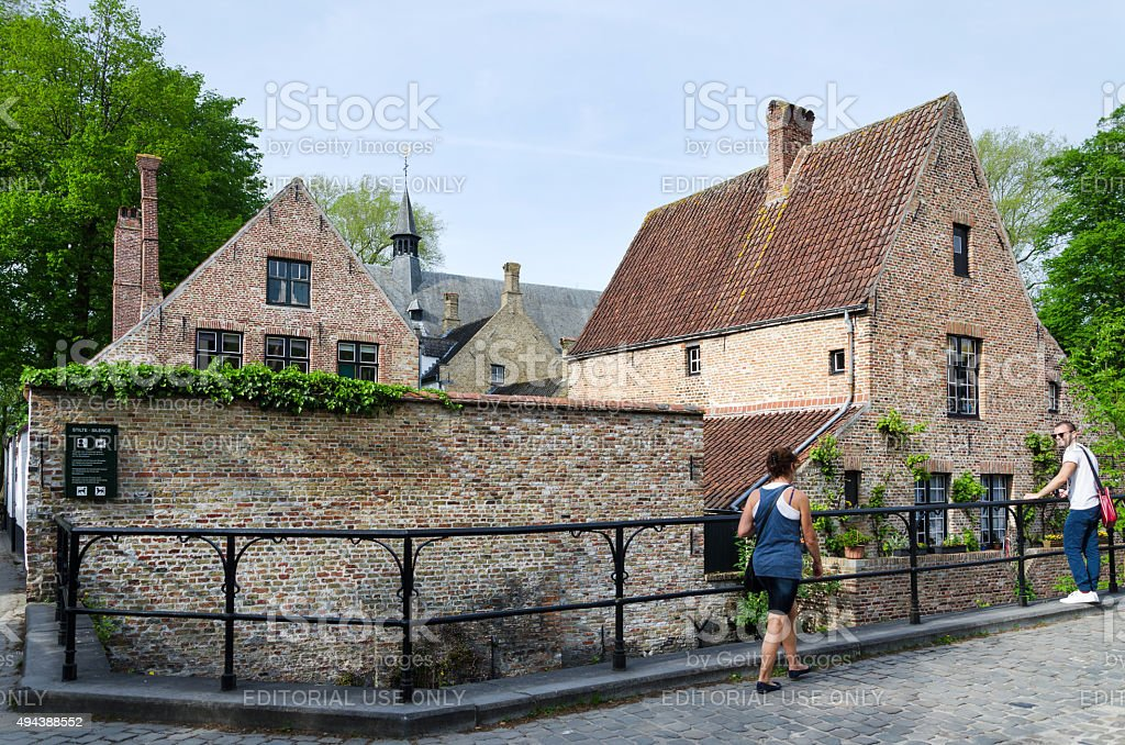 People around the Beguinage in Bruges stock photo