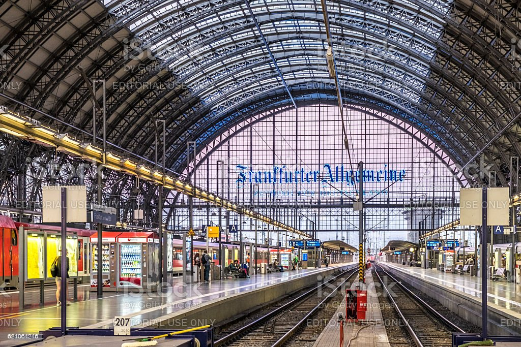 people arrive and depart at Frankfurt train station stock photo