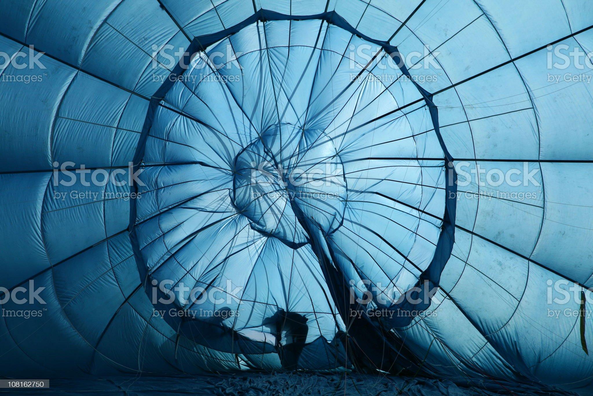 People assembling a hot air balloon royalty-free stock photo