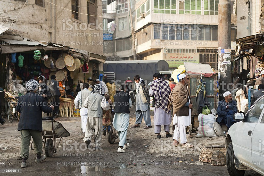 People at a back alley street corner in Kabul stock photo