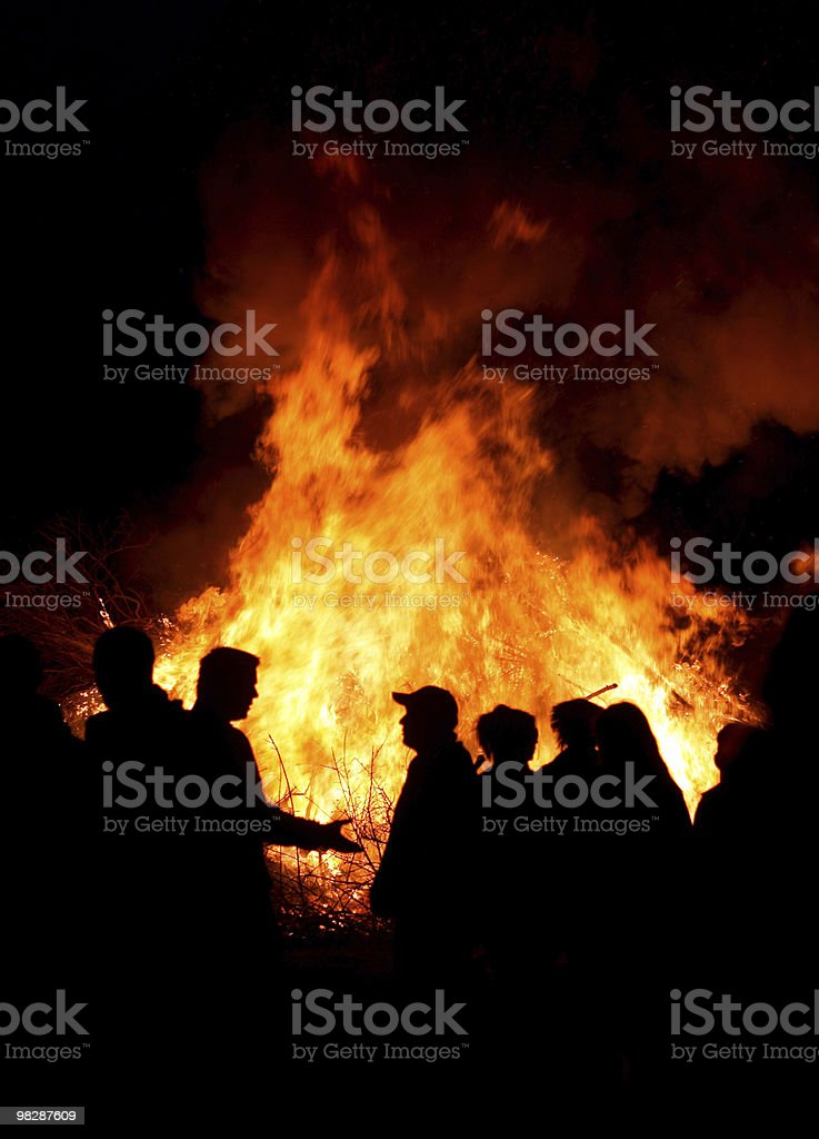 People at a bonfire stock photo