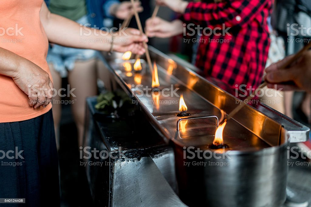 People at a Buddhist temple stock photo