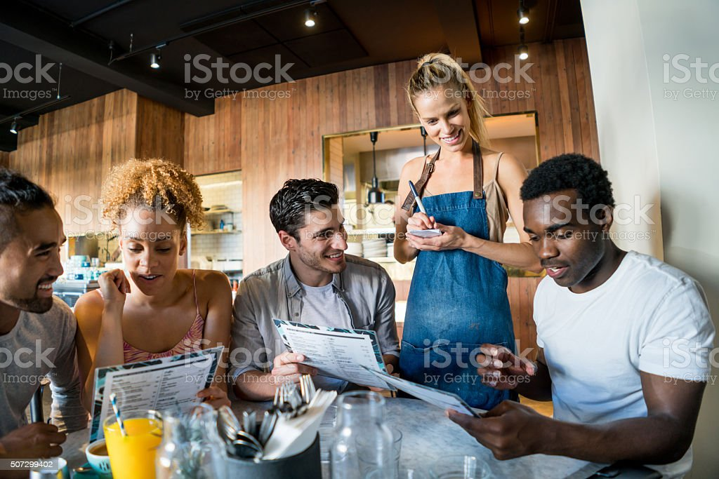 People at a coffee shop stock photo