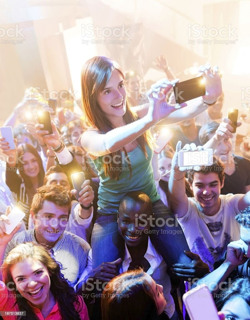 People at a concert recording with phones royalty-free stock photo