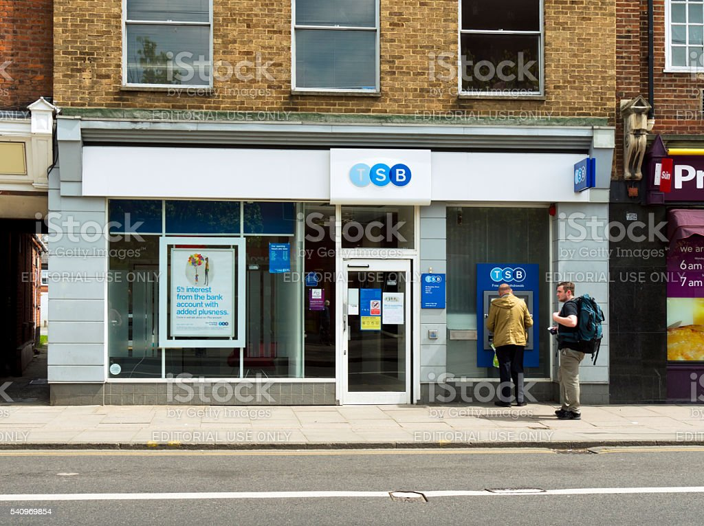 People at an ATM outside a TSB Bank branch stock photo