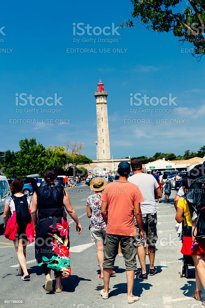 People at Baleines lighthouse, Ile de Re, France stock photo