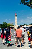 People at Baleines lighthouse, Ile de Re, France