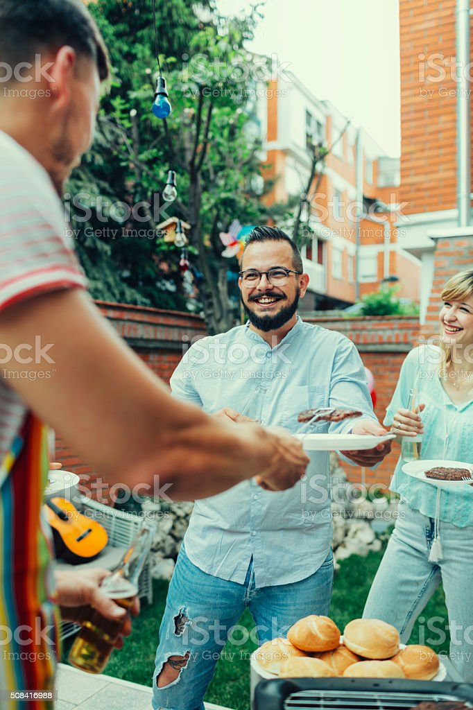 People At Barbecue Party stock photo
