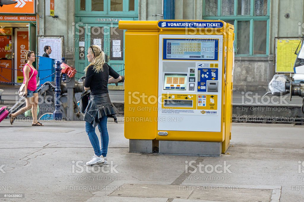 People at Budapest railway station ticket machines stock photo