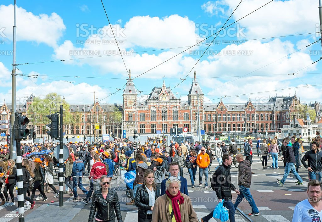 People at Central Station on Kings Day in Amsterdam Netherlands stock photo