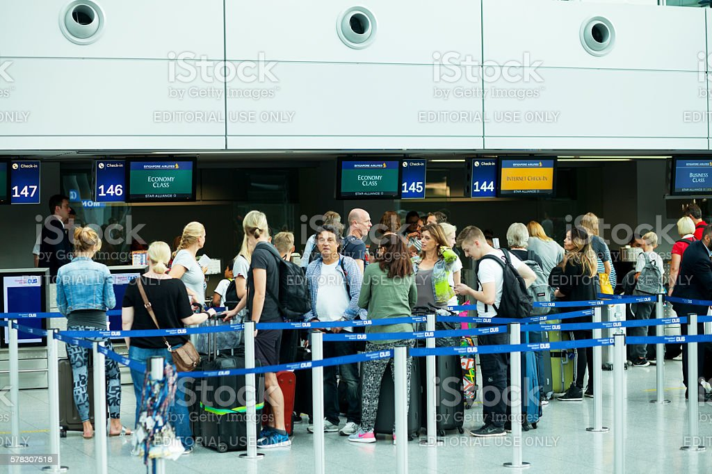 People at check-in of Condor in Düsseldorf stock photo