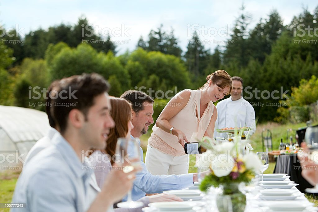 People at dinner party on a farm stock photo