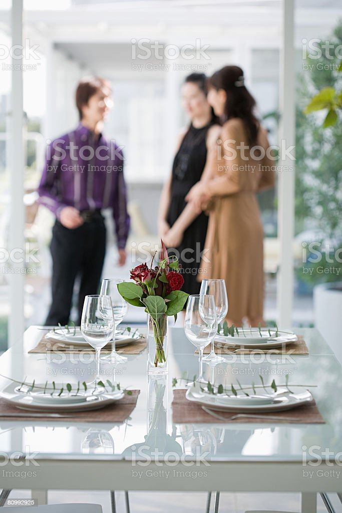 People at dinner party stock photo