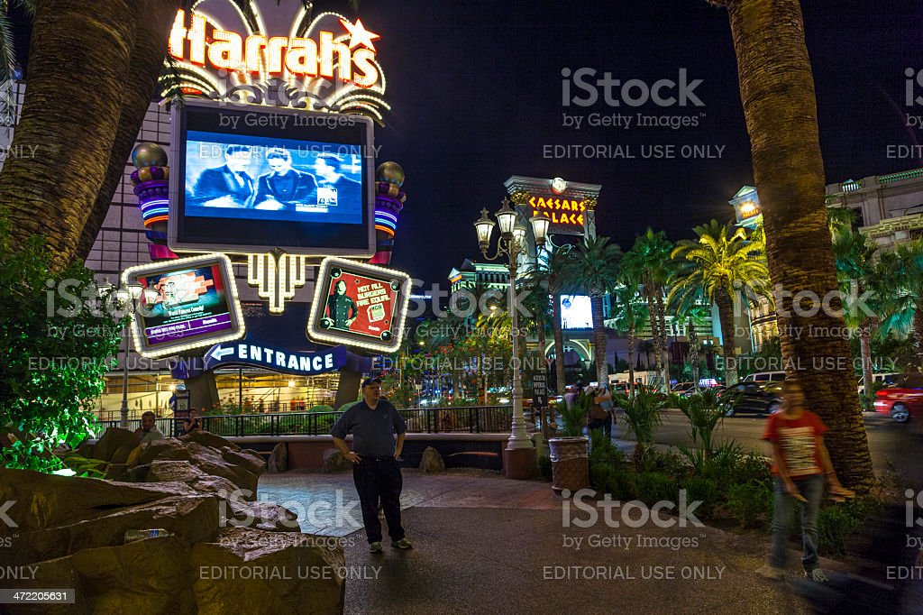 people at entrance of  Harrah`s casino and hotel stock photo