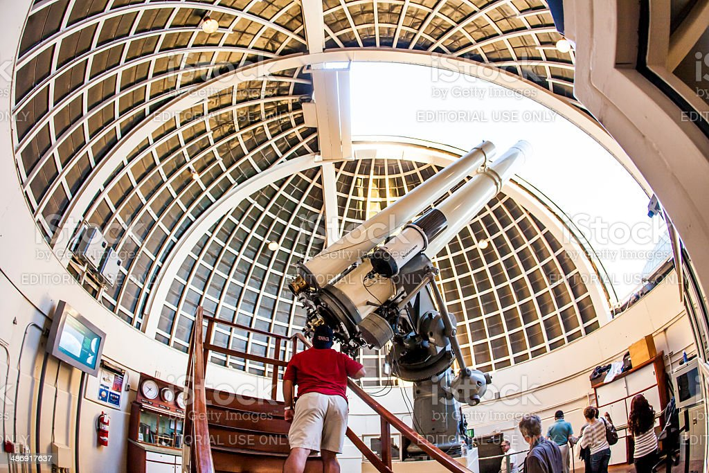 people at famous Zeiss telescope at the Griffith observatory stock photo