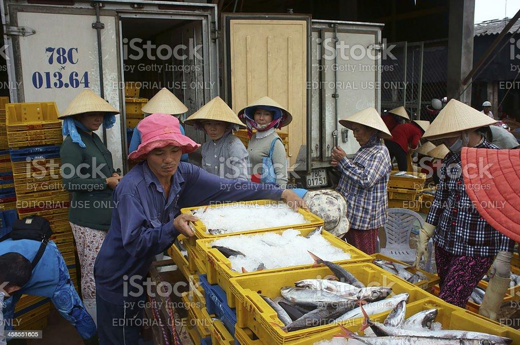 People at fishing market royalty-free stock photo