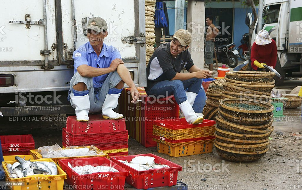 people at fishing market with smile royalty-free stock photo
