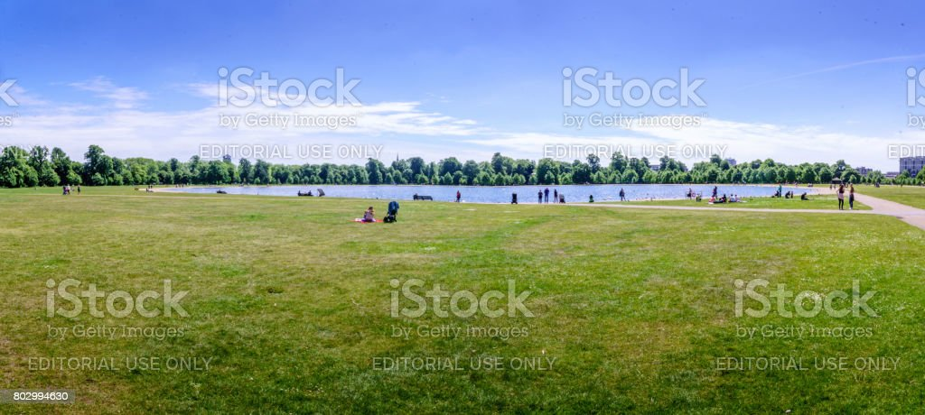 People at Hyde Park lake stock photo